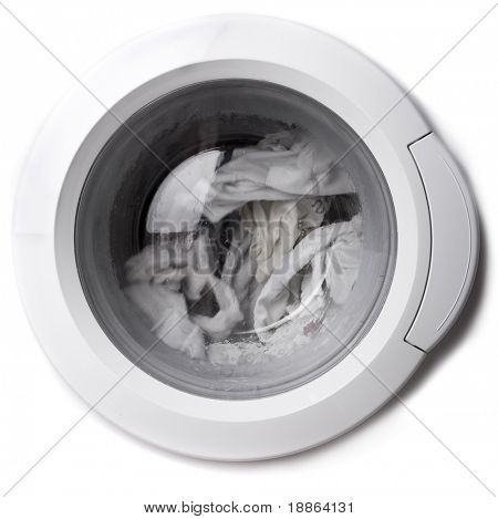Close-up of a washing machine cover with clothes in isolated on white