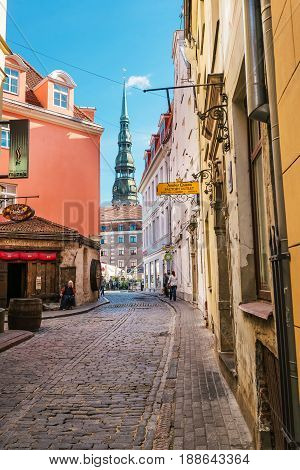 Street With People And Spire Of St Peter Church Riga