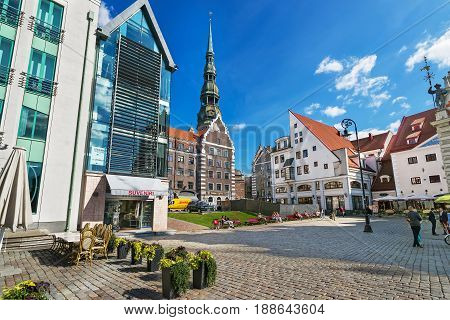 Square With People And Spire Of Saint Peter Church Riga