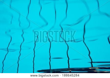 Abstract background underwater light patterns in swimming pool.