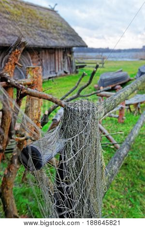 Fishing Net On Fence At Ethnographic Open Air Village Riga