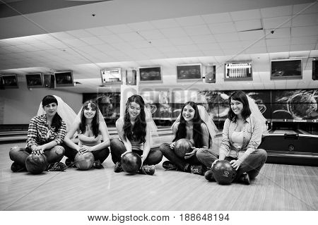 Group Of Six Girls Wit Bowling Balls At Hen Party On Bowling Club.