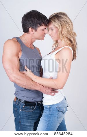 The sexy couple is about to seduce one another.