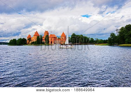 People In Sailing Boats On Galve Lake Trakai Island Castle