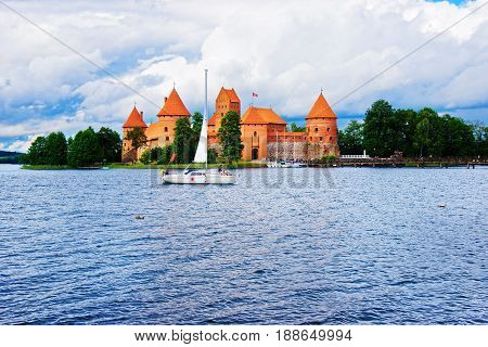 People In Sailboats On Galve Lake Trakai Island Castle