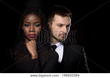 Close up portrait of multi ethnic man and woman. Dark skinned woman posing with european man. Couple posing together.