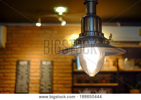 Vintage hanging lamp decoration in coffee shop