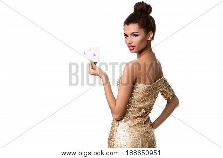 Pretty african girl shows two aces in casino poker and win Young woman in studio on white background