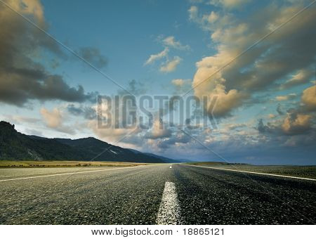 Road and the dramatic sky with strong perspective