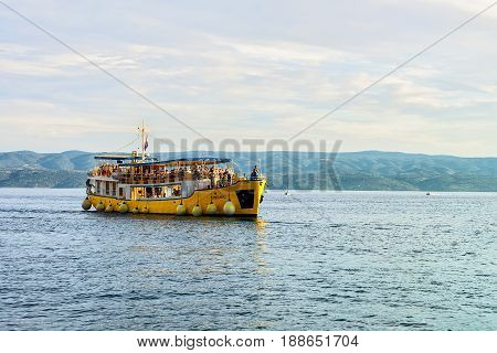 Excursion Ferry With Tourists At Harbor In Adriatic Sea Omis