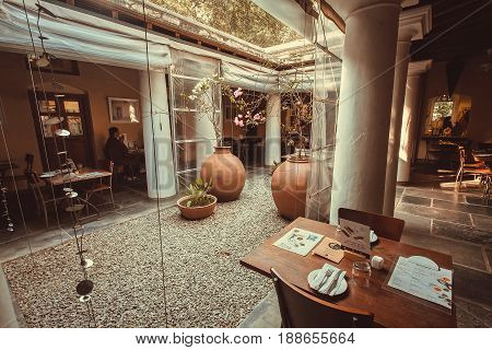 BANGALORE, INDIA - FEB 14, 2017: People have dinner inside luxury restaurant in retro indian style on February 14, 2017. With population 8.52 million Bangalore is the third most populous indian city