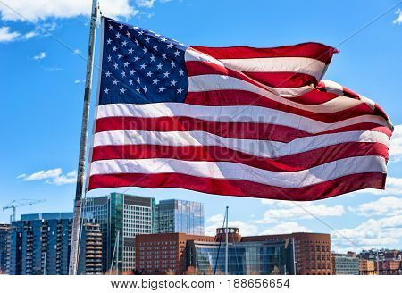 Boston Waterfront And Skyline And United States National Flag Ma