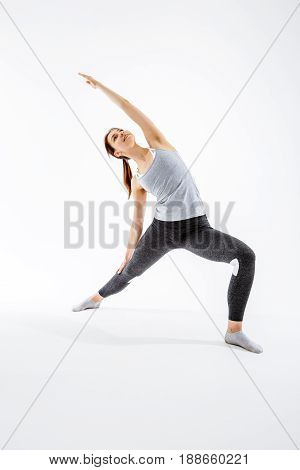 Young girl practicing in yoga on blank background