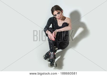 Woman On Rollers With Fashionable Makeup And Long Brunette Hair