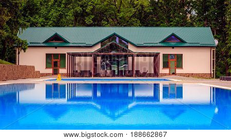 Very beautiful in the blue water is reflected the building decorated with garlands is a place for tourist rest
