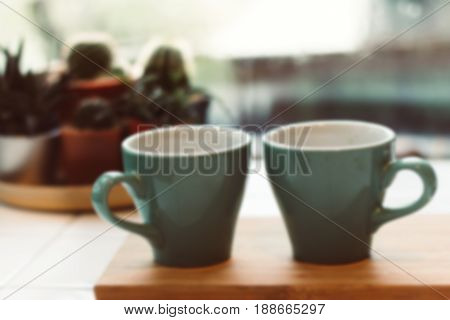 Blur image Two cups of espresso on wooden tray Coffee cup in coffee shop Vintage style.