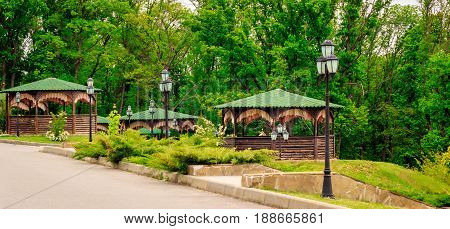 Wooden arbors beautiful lights magic nature around everything green a magical place for a tourist rest
