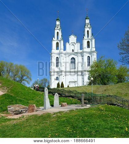 POLOTSK BELARUS - MAY 19 2017: Unknown people are near St. Sophia Cathedral. On foreground - cult complex (source and stone-altar) Polotsk Belarus