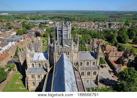 ELY, UK - MAY 26, 2017: Aerial view of the East part of the Cathedral with the Octagon in the center and the countryside in the background - picture taken from the top of the West Tower of the Cathedral