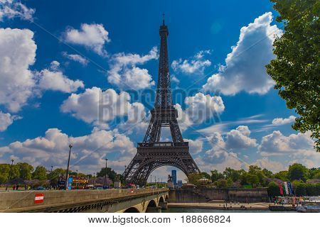 embankment and road near eifel tower with cloud sky on background in spring time