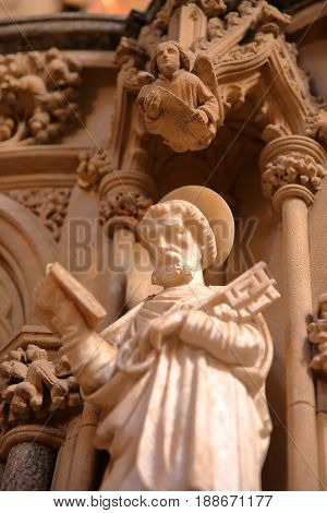ELY, UK - MAY 26, 2017: The interior of the Cathedral - Close-up on a statue of St Peter holding a key