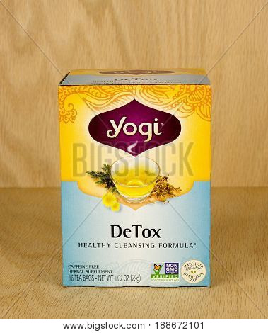 RIVER FALLS,WISCONSIN-MAY 29,2017: A box of Yogi brand detox tea with a wood background.