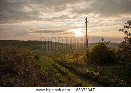 Golden sunset. Moldavian fields and hills. Spring or summer sunny down landscape