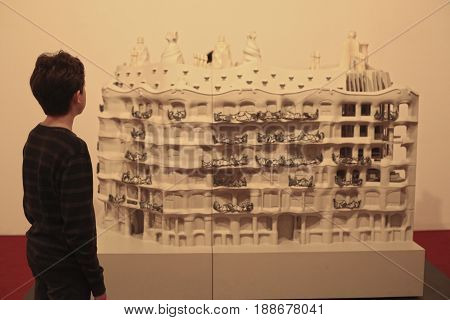 Moscow, Russia - May 25, 2017: Unidentified preteen kid boy at Gaudi architectural exhibition looking at famouse house maquette in Moscow, May 25, 2017
