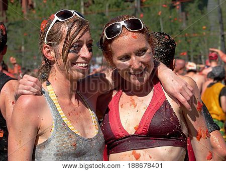 Colorado tomato battle at Copper Mountain Ski Resort - June 25, 2011. Two female fighters posing just after the battle finished.  Colorado tomato battle is an annual summer event at Copper Mountain Ski Resort