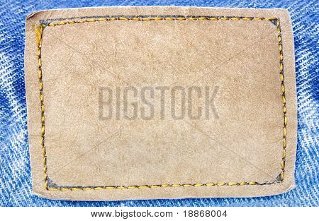 One  brown label on blue jeans