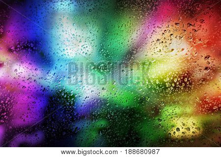 Abstract background of laser show in modern disco party night club : Concept of nightlife with music and entertainment. Rain drops on the glass. The selected focus. poster