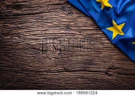 Flag of Europe union on old wooden background. EU flag old oak background.Horizontal.