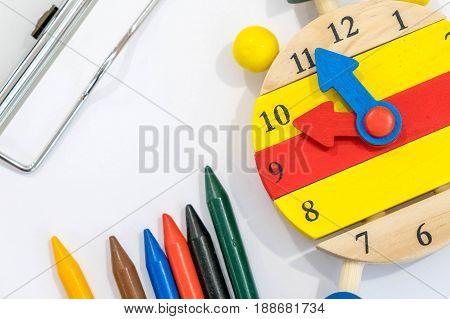 Back to school background with books and alarm clock over chalkboard. Creative desktop.Modern desgin, vivid colors. Office, school.
