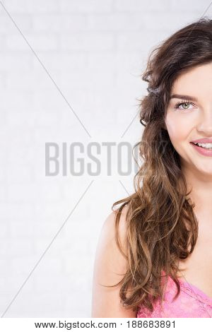 Brunette young woman with dark brown eyes smiling