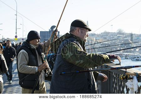 ISTANBUL, TURKEY - 1 APRIL , 2017: Fishermen are fishing on the banks of the Bosphorus in Istanbul Turkey