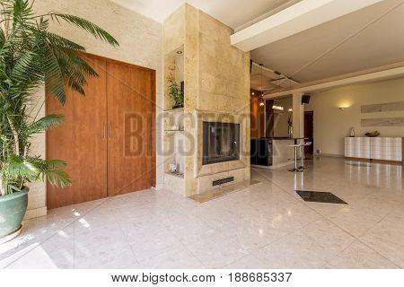 Elegant Hallway With Travertine Fireplace