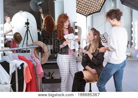 Make-up Artists Preparing Professional Model