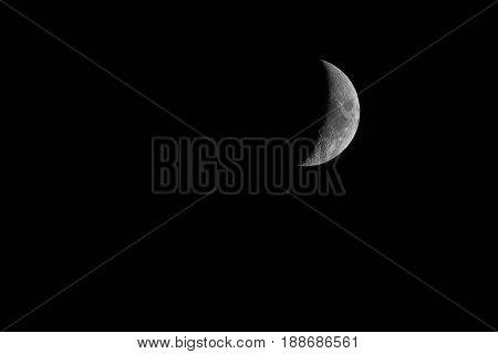 Nice mystical half moon on dark night sky background.