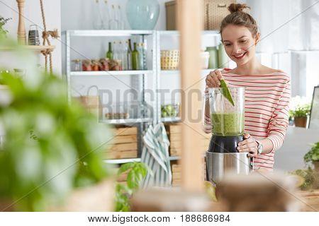 Woman Using Blender