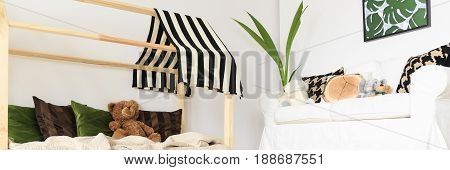 Panoramic view of natural black white and green kids room