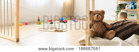 Sandpit and toys in natural kids room