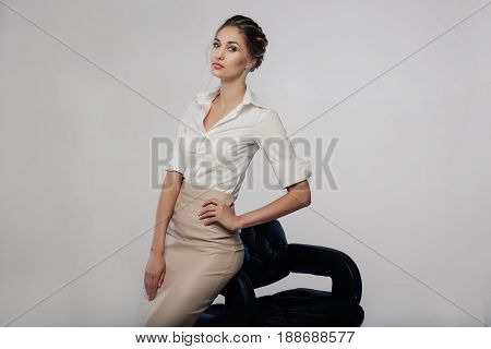 Beautiful Elegant Young Bussines Woman Standing On The Studio With Gray Background