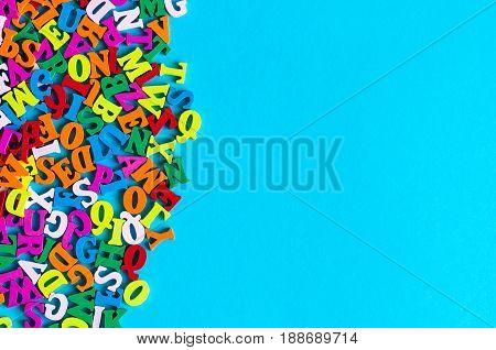 English letters on blue background composed from colorful abc alphabet leter. Back to school concept or Learning english or other language courses. Empty space, Copy space.