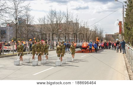 Kirishi, Russia - 9 May, People with a large St. George's flag, 9 May, 2017. Preparation and conduct of the action Immortal regiment in small cities of Russia.