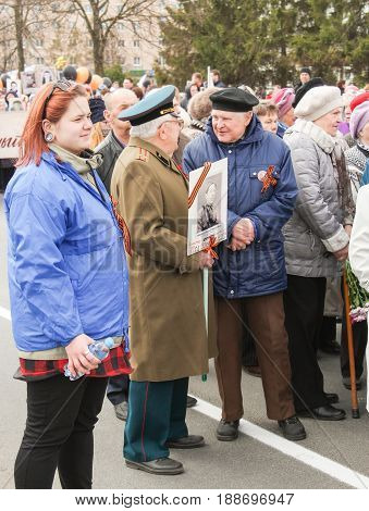 Kirishi, Russia - 9 May, Older veterans in the column, 9 May, 2017. Preparation and conduct of the action Immortal regiment in small cities of Russia.