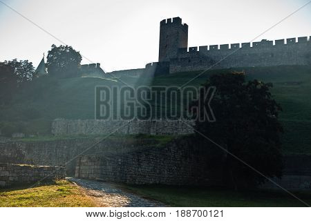 Play of shadow and light below Kalemegdan fortress tower at early morning in Belgrade, Serbia poster