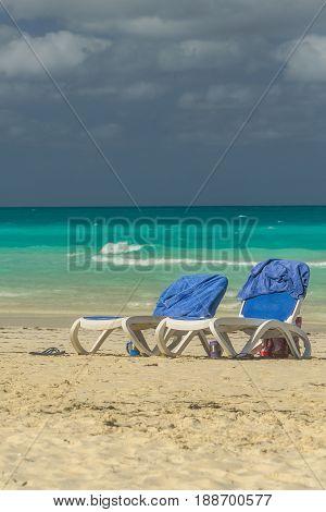 Sunbeds on tropical beach in island Cayo Santa María. Cuba