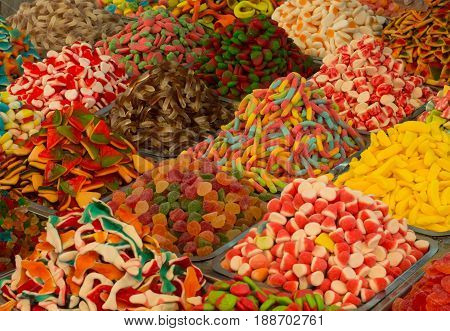 Collection Of Colorful Gummy Candies At Market. Top View. Close-up
