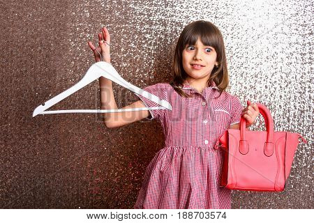 Small Pretty Surprised Girl With Red Leather Bag And Hanger