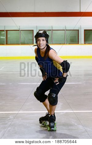 woman roller derby t stop move in roller rink
